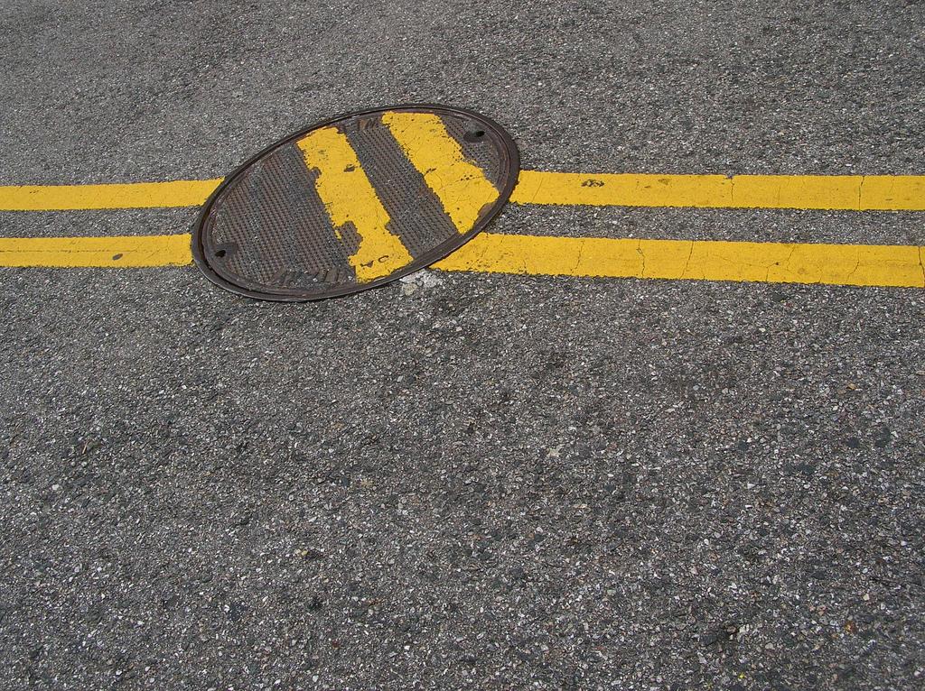 manhole-impaired yellow stripes