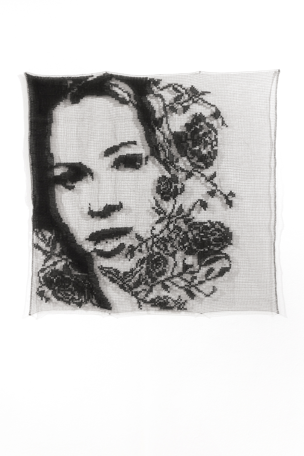 """Lace portrait of the """"villain"""" of season 22 of the Bachelor in black and white surrounded by lace roses"""