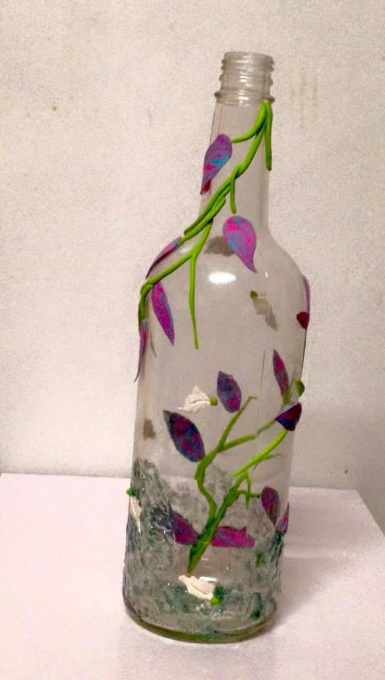 Clay on glass bottle