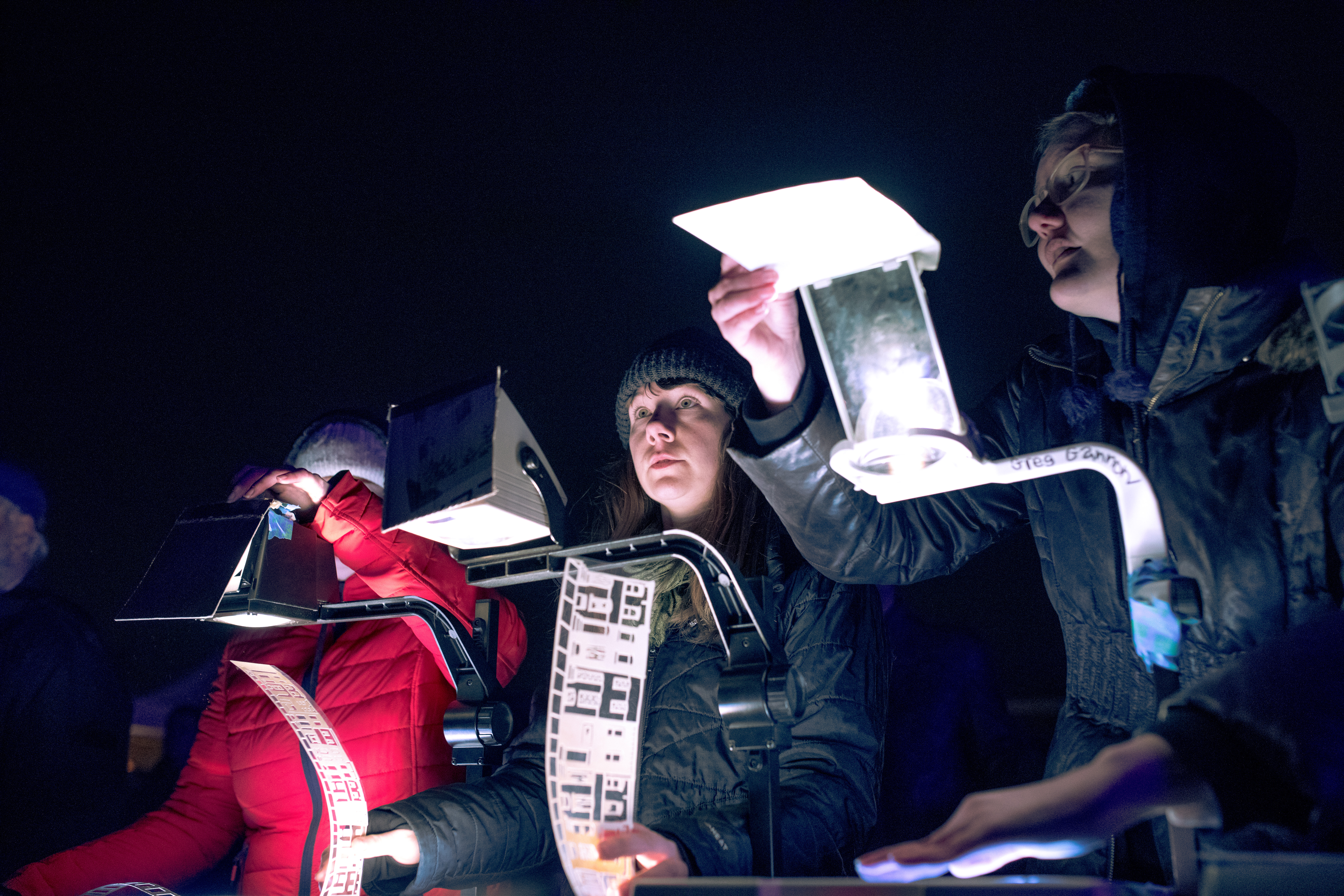 performance shot of puppeteers: Devin Martin, Emily Schubert, Emily Hall