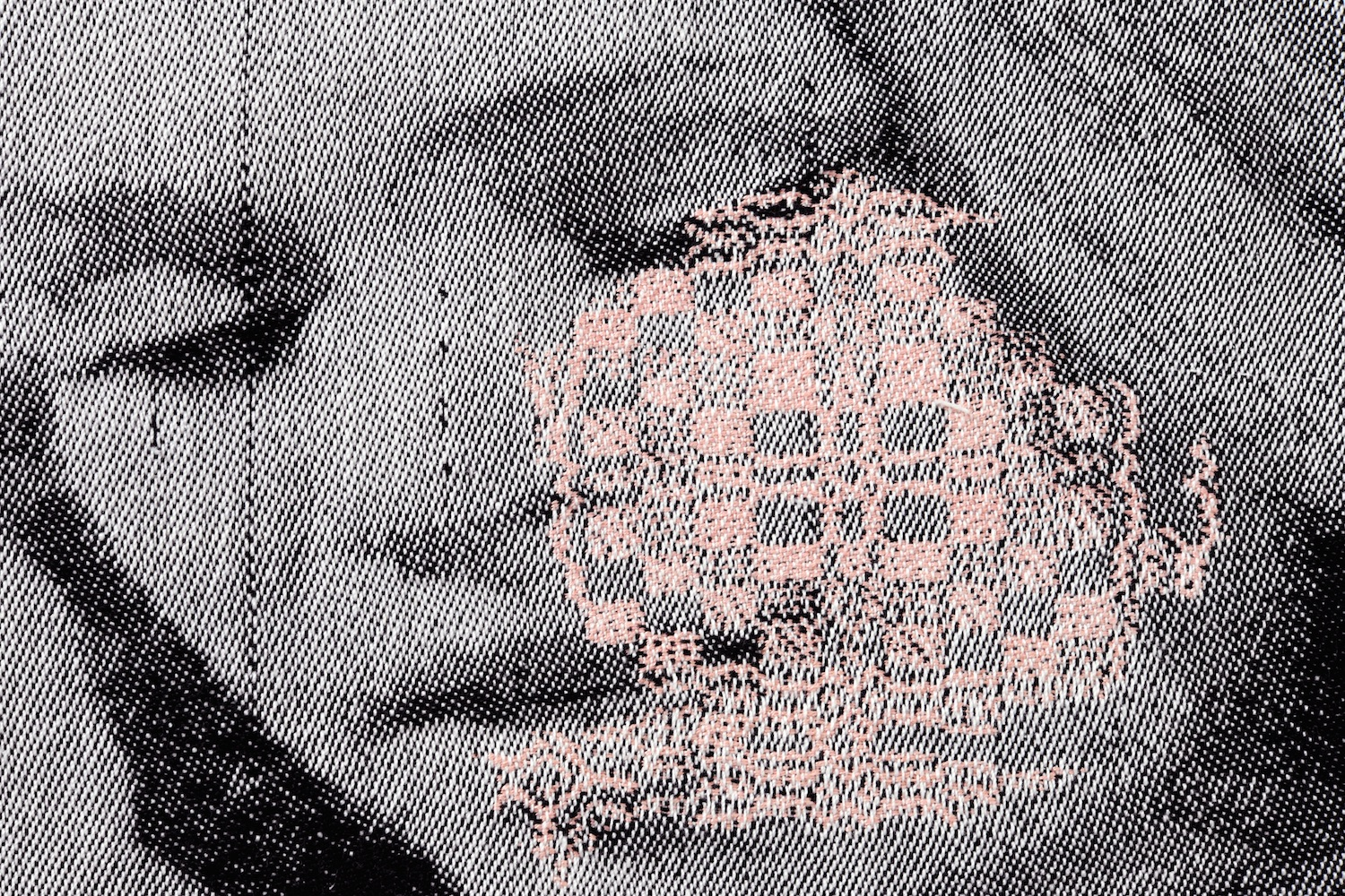 detail image of a woven portrait of a woman with a rosette pattern overlaid on her cheek