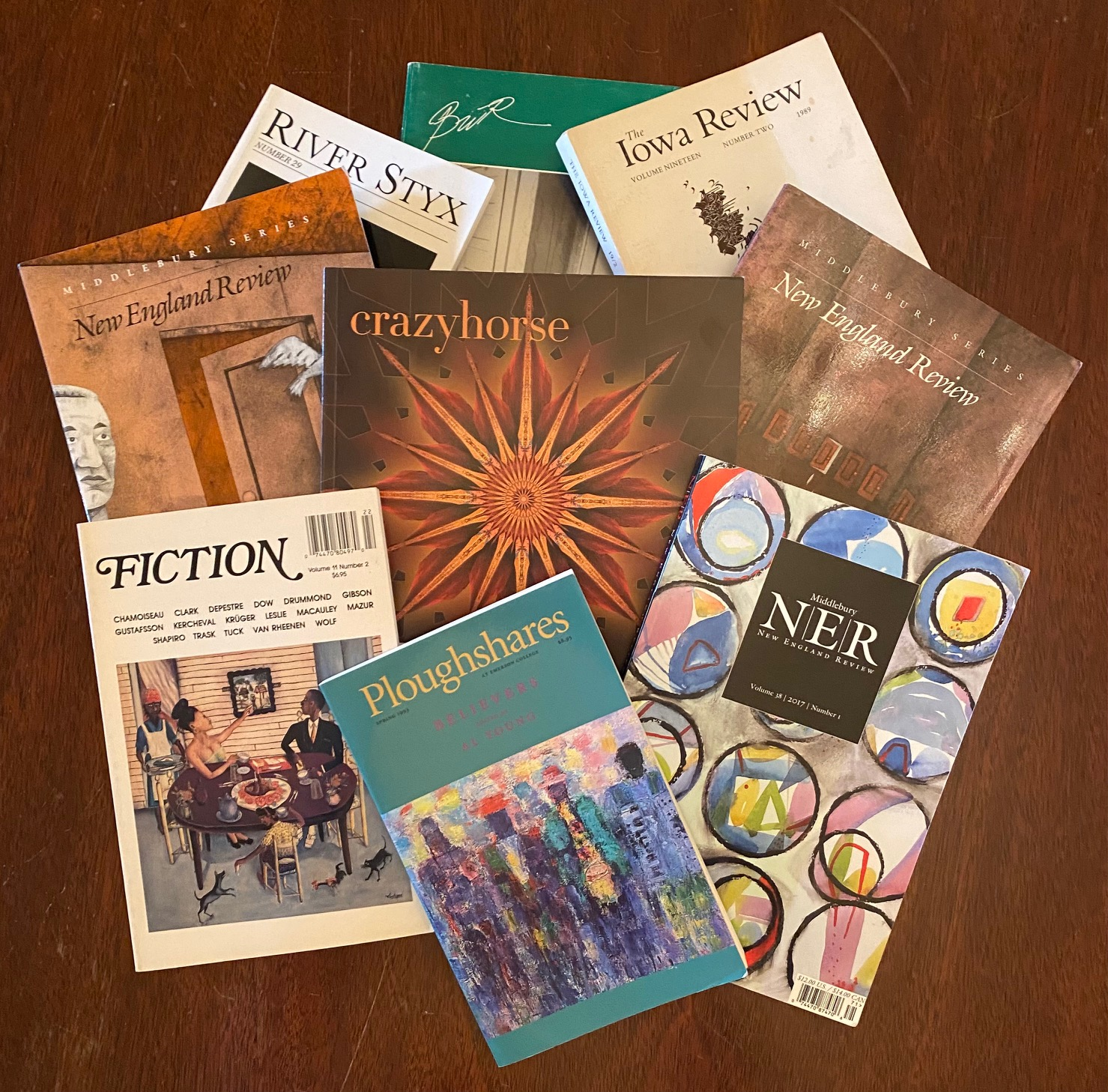 A fanned-out pile of literary magazines.