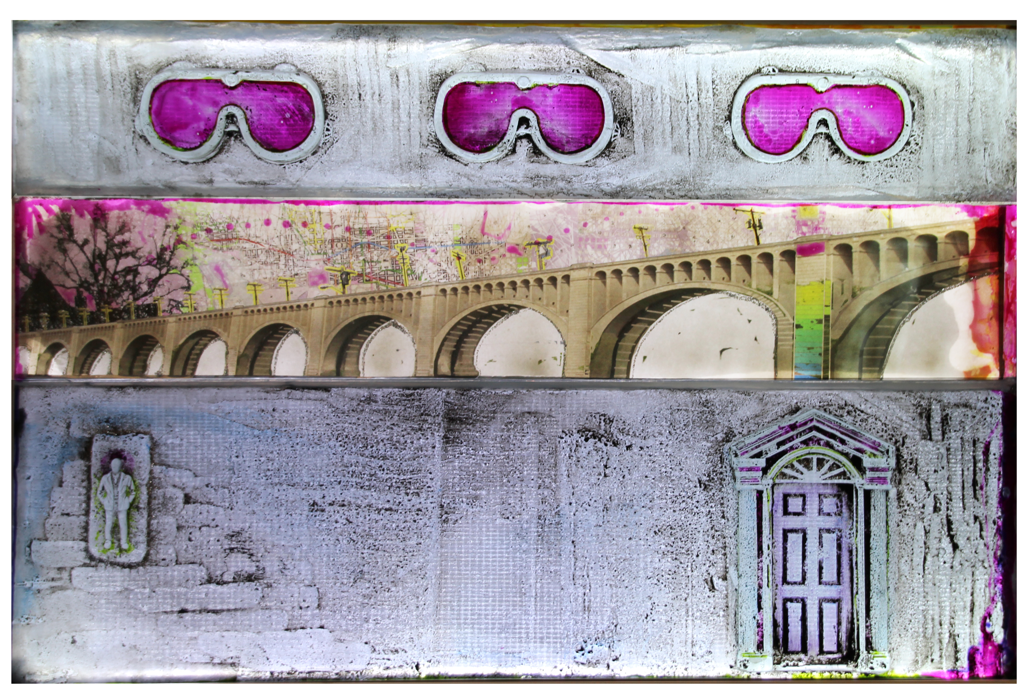 Wall relief glass sculpture with images of goggles, a bridge, a figure and a door.