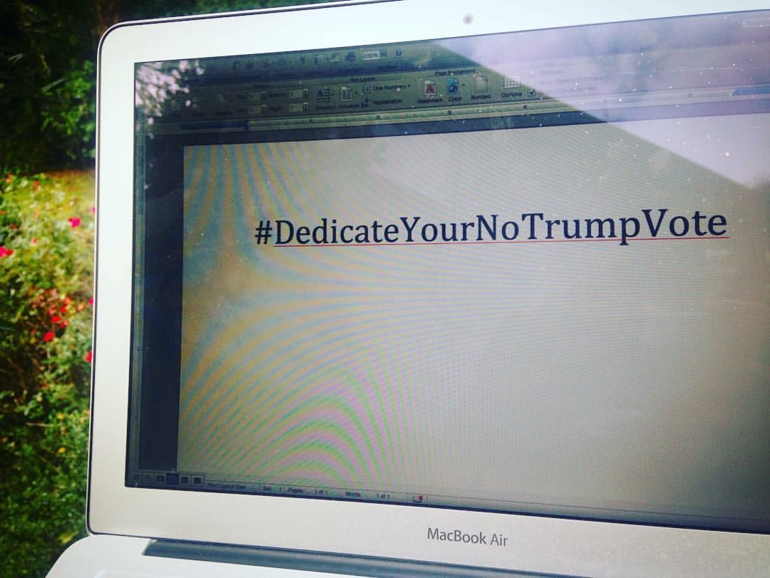 A computer screen with the words #DedicateYourNoTrumpVote
