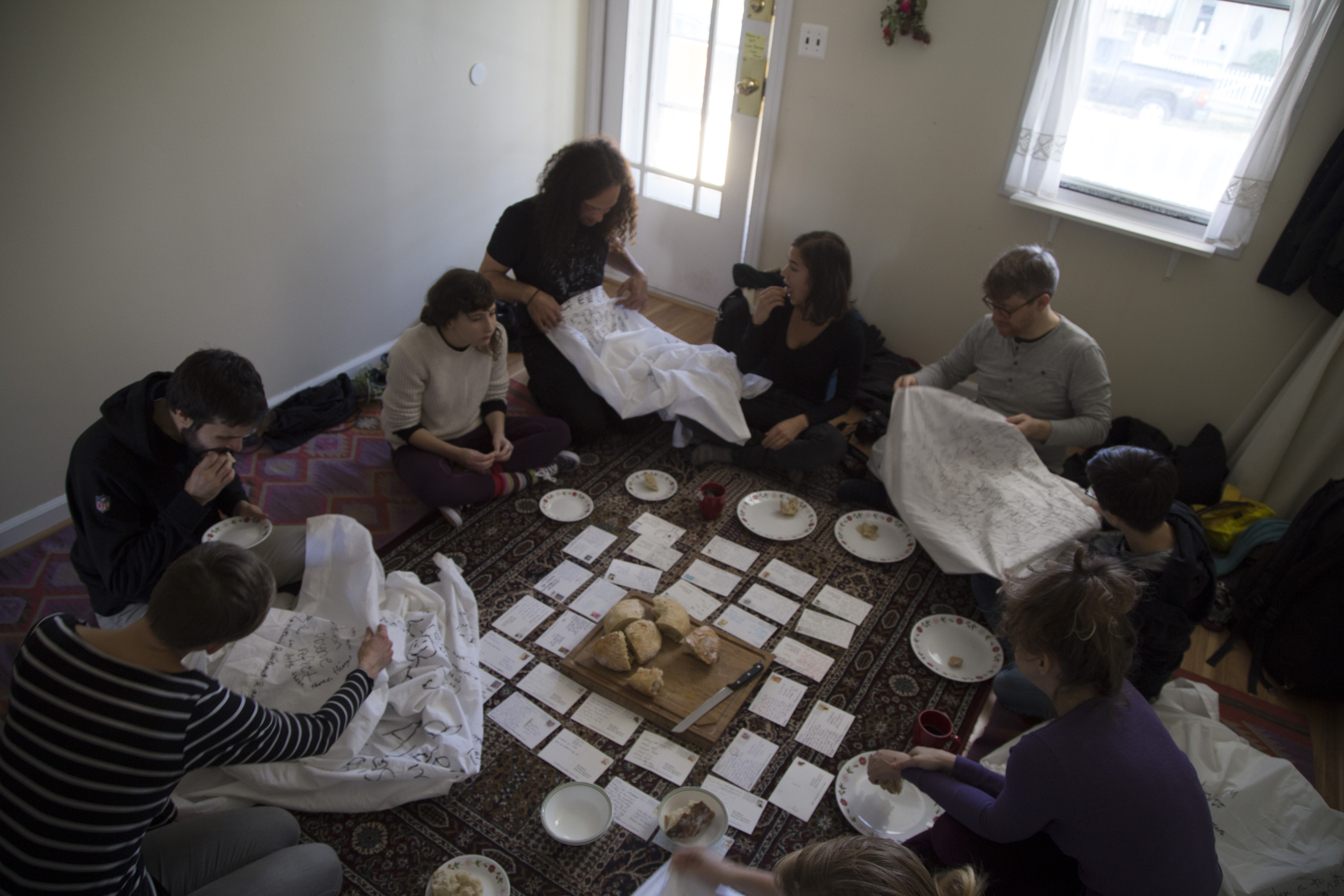 The Pilgrim House in Baltimore. Pilgrims break bread (the only food they'll have on pilgrimage) and read postcards sent from fellow travelers around the world. Photo by Katy McCarthy.