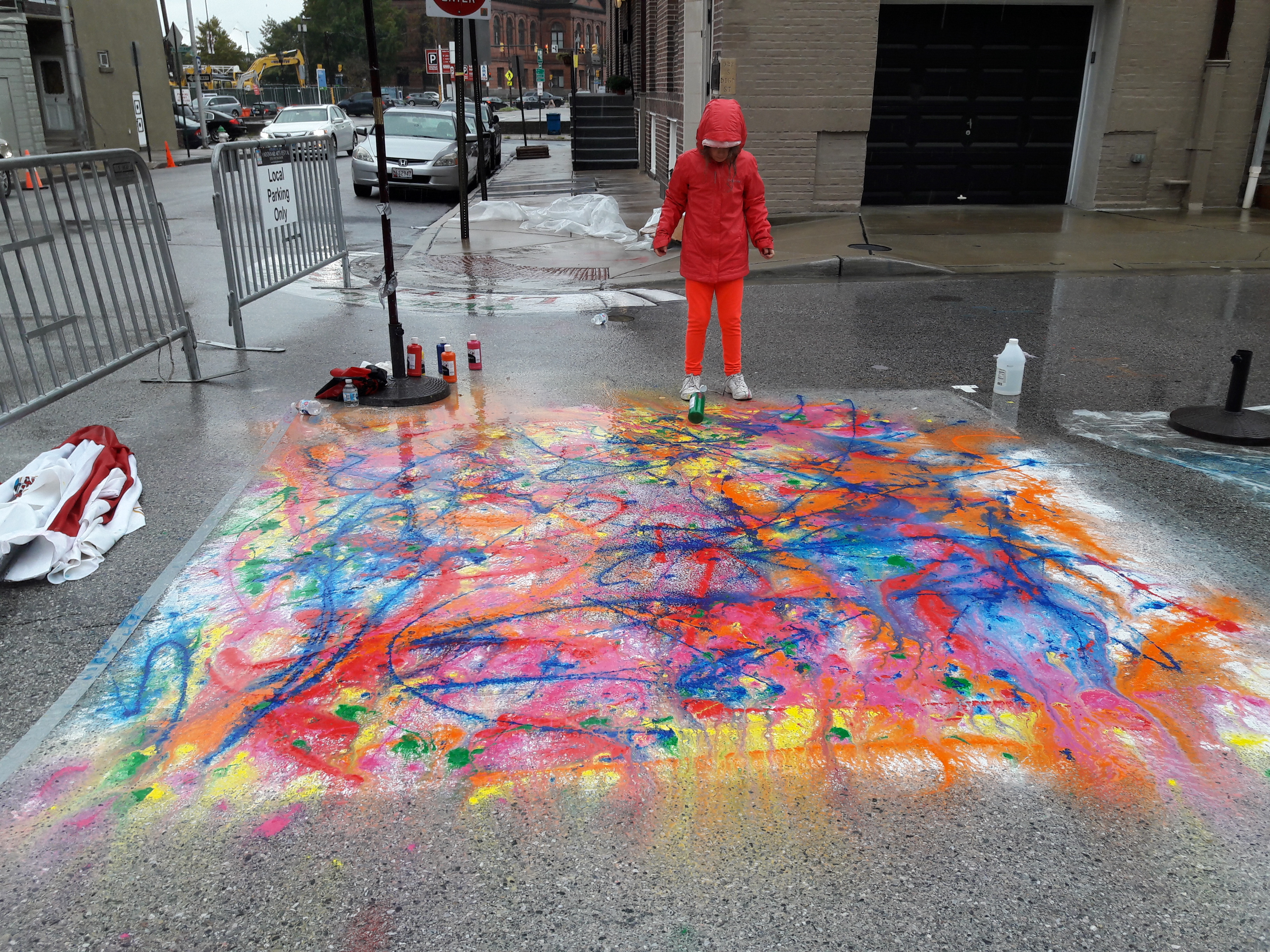 Chalk and tempera paint on asphalt.
