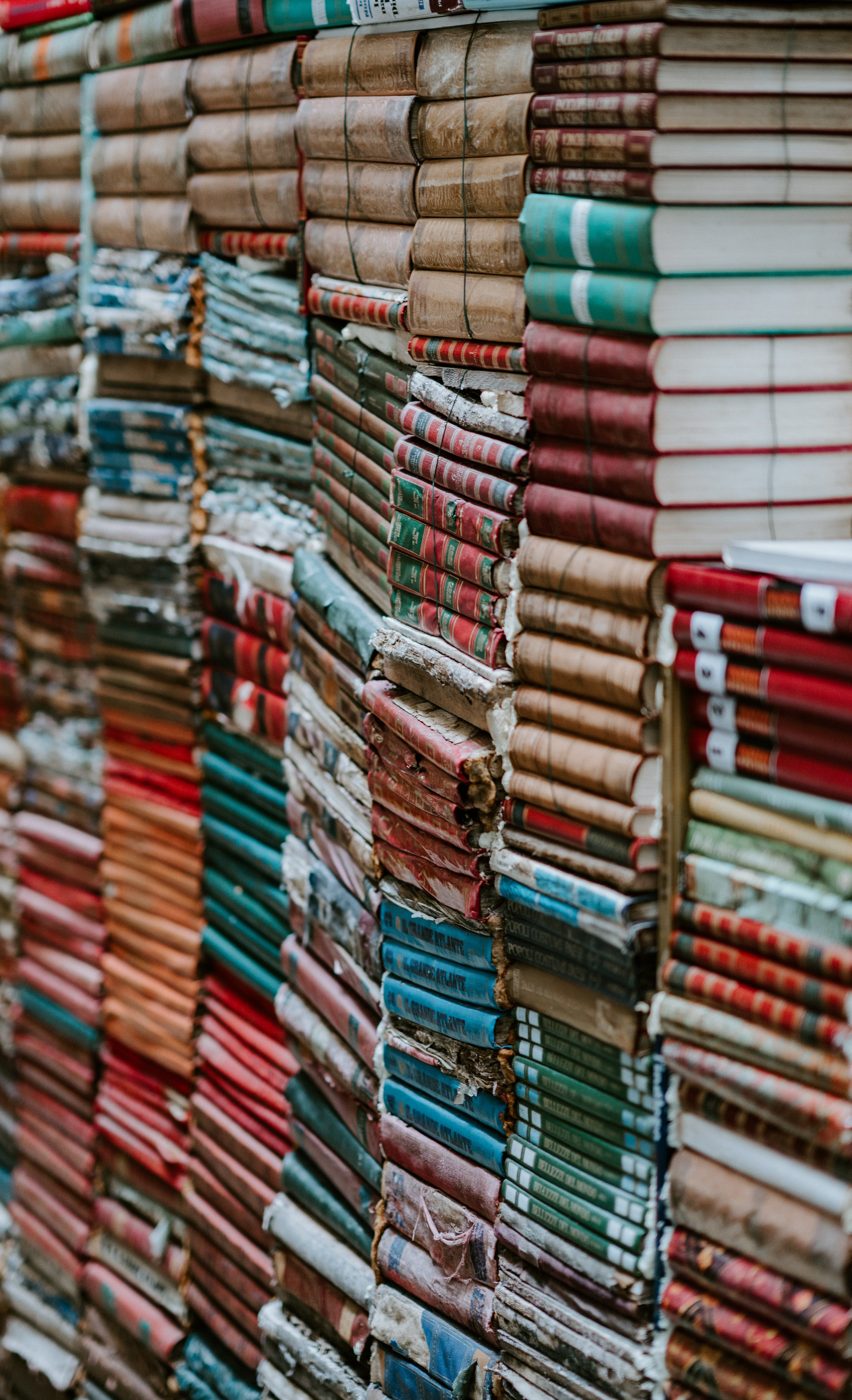Books neatly stacked with spines horizontal