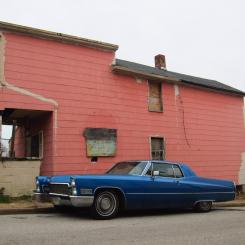 blue caddy by the pink house