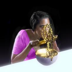 girl throwing gold liquid on her face uni sun album art