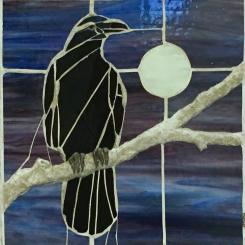Raven perching, mosaic bas relief