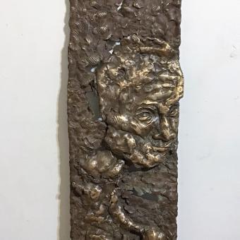 Bronze, relief head
