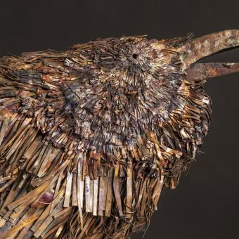 "Raven-the orator: ideogram: woodland eyes/beak, dense leaf pattern copper, stainless steel 29"" x 40"" x 10"""