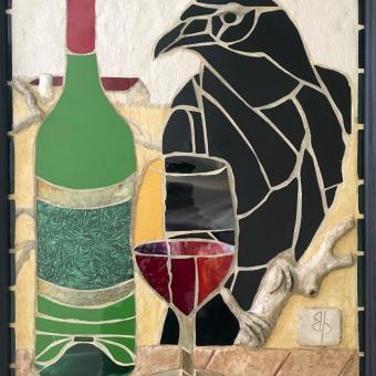 Black Raven, green wine bottle, glass of red wine in stained glass mosaic with sculpted concrete branch and picnic table in low relief, with Maryland farm in background.