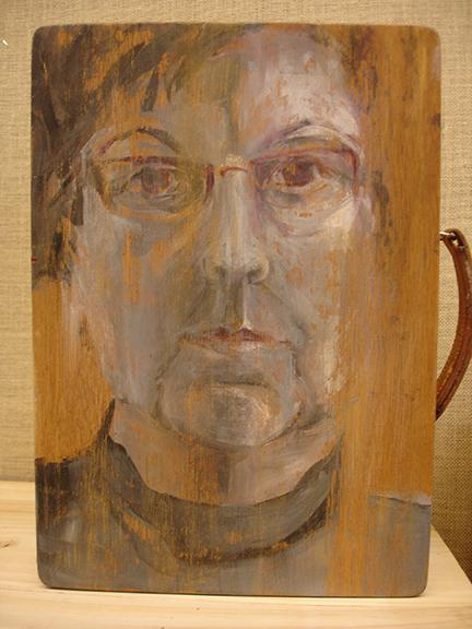 """Each artist in the Ordinary Woman Installation hung a self portrait no larger than 16"""" x 16"""" on the wall.  Diana Marta painted her acrylic self-portrait on a vintage wooden paintbox.The paint peeling effect on the box represents an active life well lived."""