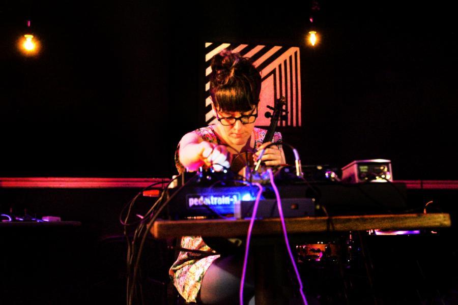 Liz Meredith solo performance: violin/electronics. Baltimore MD, 2014.
