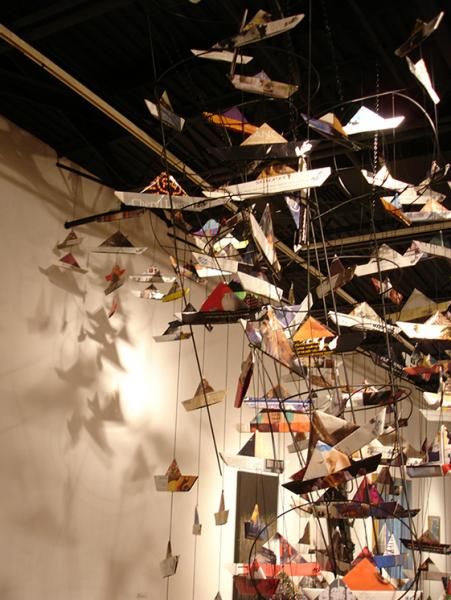 Shadows on the wall and movement of some of the boats give an extension and liveliness to the Maelstrom Installation at the Howard County Center for the Arts in December of 2014