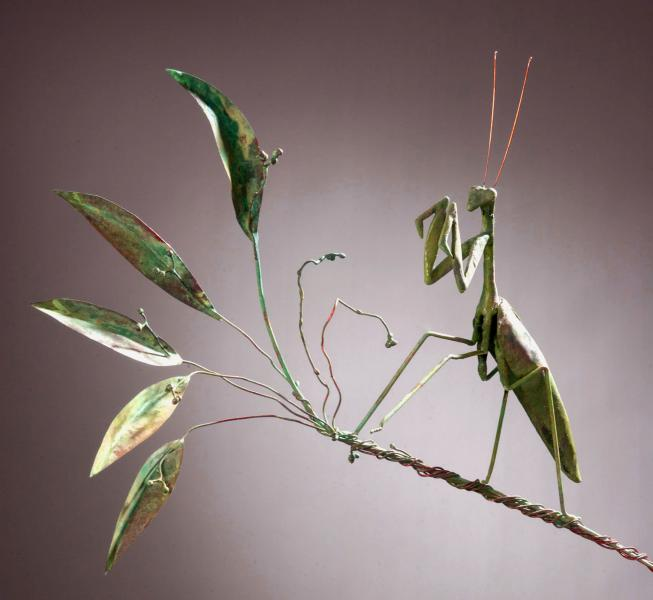"One of the first works completed as part of this project was a 96"" high sculpture of a praying mantis poised patiently on a steel rod of grass. I chose the praying mantis because of it's architectural body and the inherent symbolic meaning attributed to t"