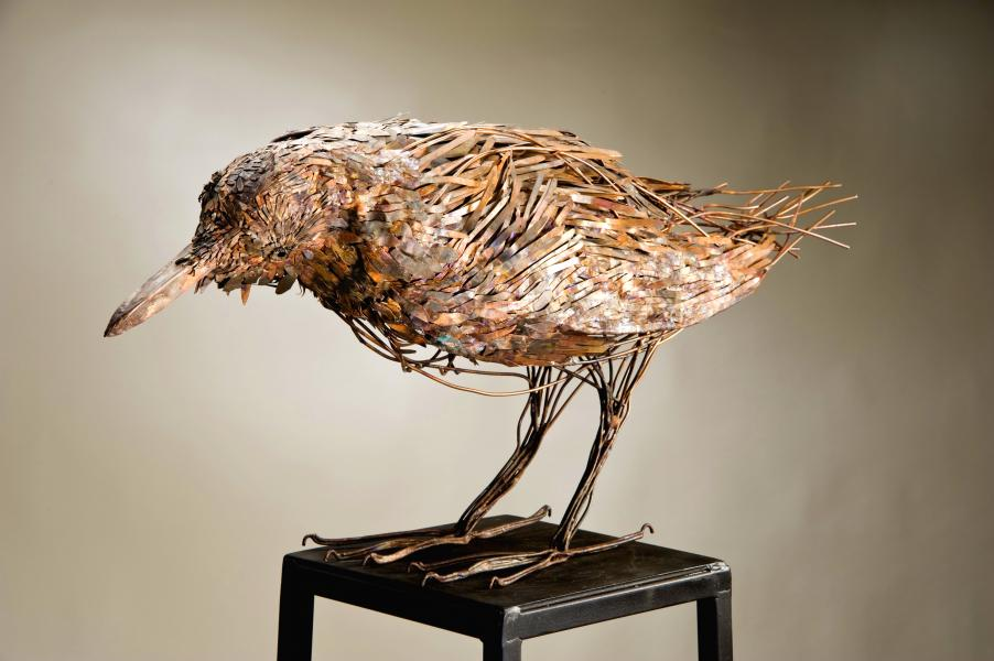 """Raven-in thought The ravens intelligence and curiosity is a constant wonder to observe. ideogram: woodland beak/eyes/claws-danger, dense leaf pattern, tangled invasive vines copper, bronze  36""""L x 15""""H x 13""""W"""