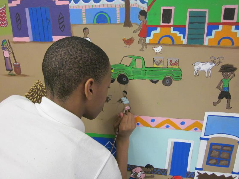 Student at work on the mural