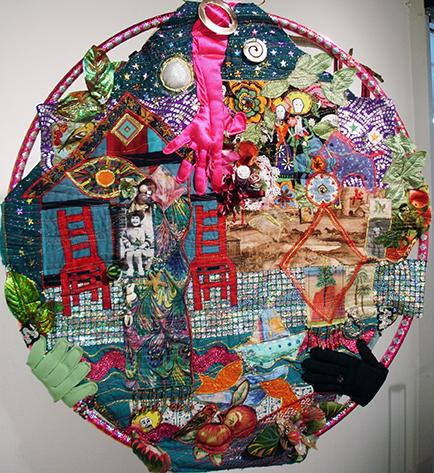 """Other side of """"hula hoop quilt"""" self-portrait. Fabric and collected memorabilia, quilted and supported on hula hoop.  Nov 2013"""
