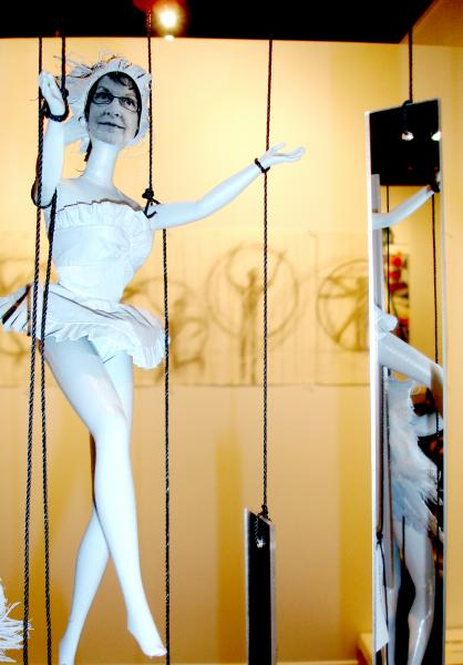 """Detail from """"IF"""" installation of puppets made with recycled 12"""" dolls, accompanied by a group of shadow-like drawings.  10' x 16' x 3'.  Acrylic mirrors are used, too."""