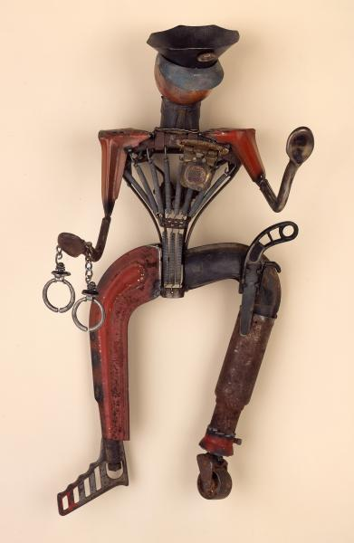 found objects, assemblage, repurposed, mixed media, police