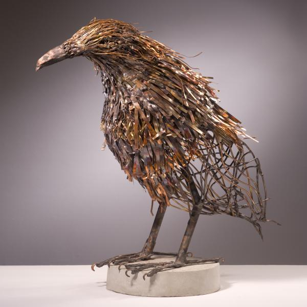 """Raven-the Statesman, each bird in the series is different, capturing a different aspect of the birds essence.  ideogram: woodland beak, dense leaf pattern, tangled of invasive vines, detritus of man copper, bronze 45""""L x 43""""H x 15""""W"""