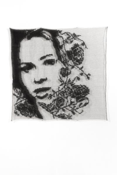 "Lace portrait of the ""villain"" of season 22 of the Bachelor in black and white surrounded by lace roses"