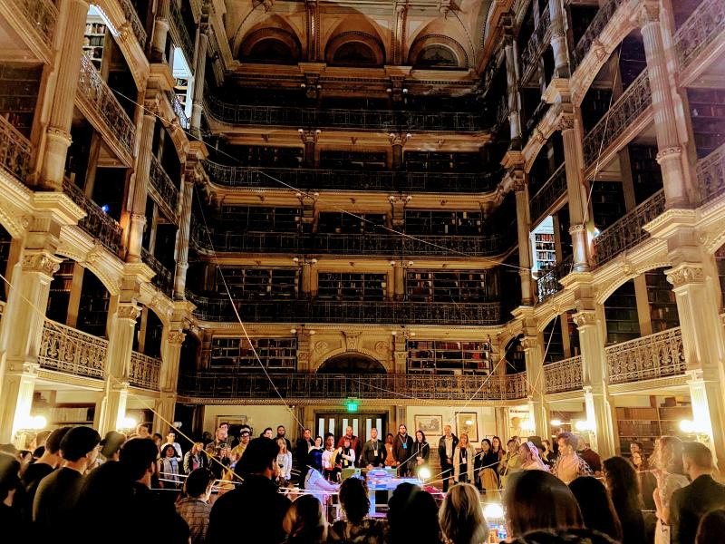 The culminating scene of See Also at the George Peabody Library with audience and cast members