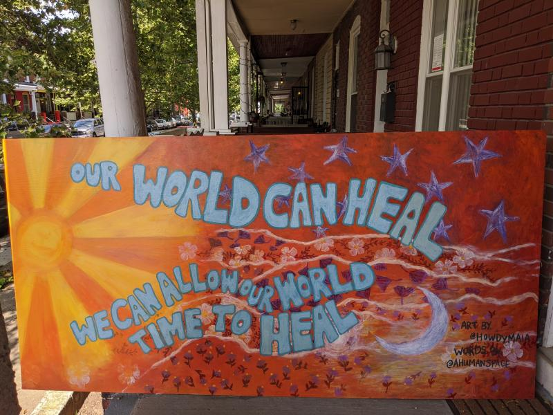 "Mirkwood Mural with sun, flowers, and starts that reads, ""Our world can heal. We can allow our world time to heal."""
