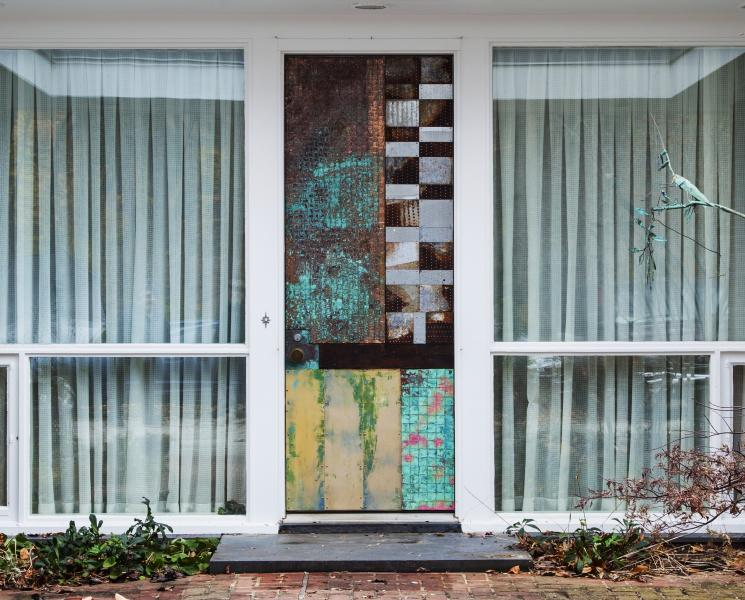 "Scrap copper and recycled steel sculpture mounted on an entry door. 108"" h x 39""w. Part of the complete rebuild of a classic mid-century modern Atomic Rancher designed to meet present day LEED standards. Geothermal heating and cooling, combined with passi"