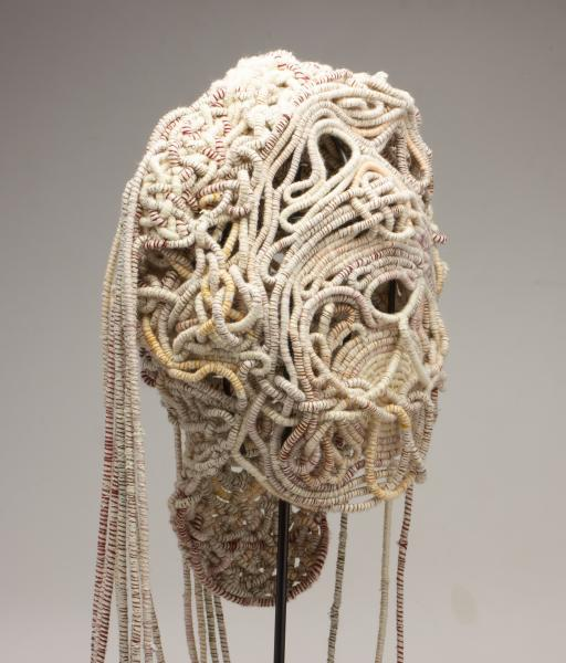 Coiled Mask 4 (profile), thread and rope, 2021, 60 x 15 x 11 inches