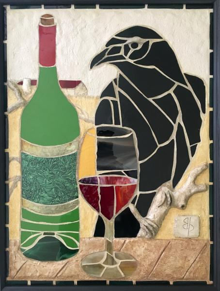 Stained glass mosaic of green wine bottle, glass of red wine and black raven perching on sculpted concrete tree branch beside picnic table surface with Maryland farm in the background.