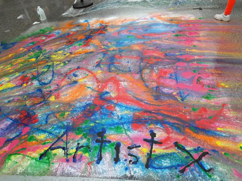 Chalk and tempera paint on asphalt.