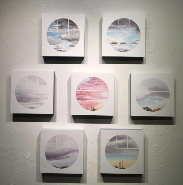 """Series of small watercolor paintings displayed together. Each shows a small circular """"window"""", through which to view a landscape beyond. The landscapes interact with architectural forms that enter the field of view in different forms."""