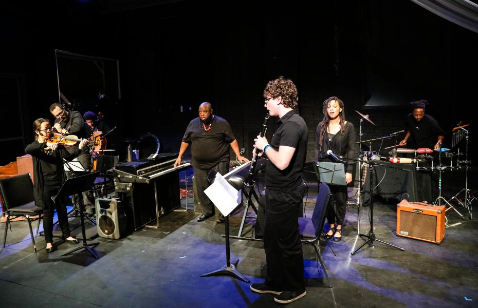 Color image of the ensemble performing.
