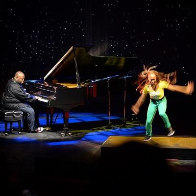 Color image of Scott Patterson and Camille A. Brown performing