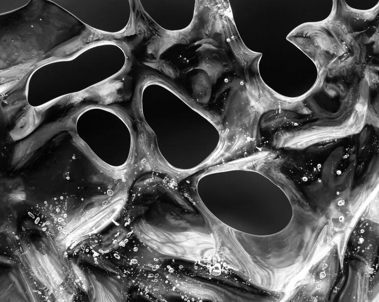 Obsidian ice sharp black white abstract holes macro closeup Morgan Run Creek Westminster Carroll County Maryland