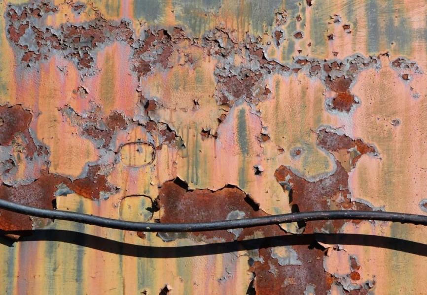 Remnants railroad rail car weathered peeling paint metal Steamtown National Historic Site Scranton Pennsylvania