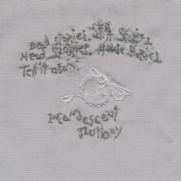 Words with embroidery on silver.  Dead stories.