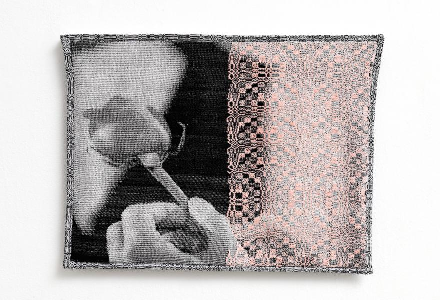 Woven image of a hand holding a rose. Half the image is veiled by a rosette weaving pattern