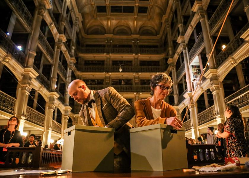 See Also - performers David Brasington and Ursula Marcum rewind the connecting threads back into their archive boxes at the close of the show in the library
