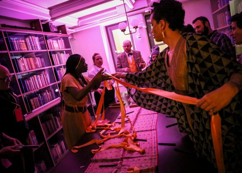See Also - performers Trustina Sabah, Susan Stroupe, David Brasington and Kaya Vision interact with audience members in a library alcove