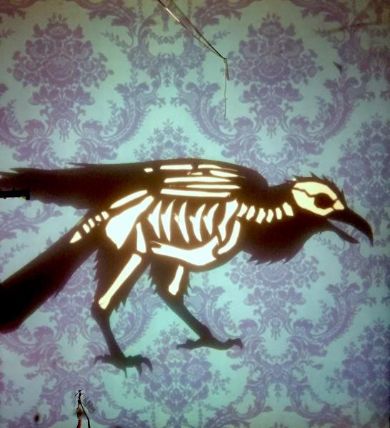 As lightning flashes we see the skeleton of the raven.