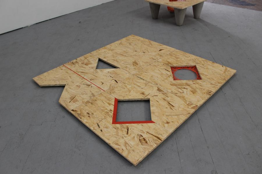 four modular floor tiles are transformed and rejoined