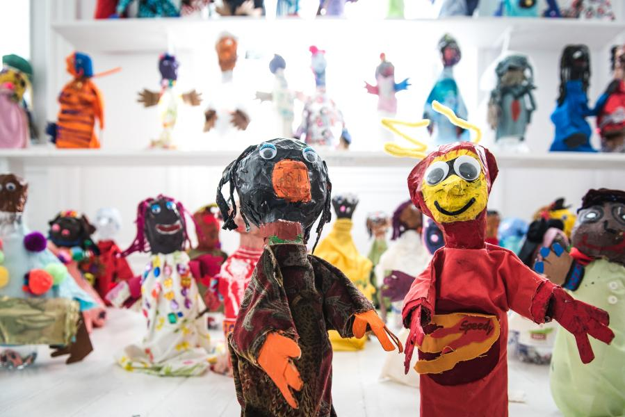 The Superhero Puppet Project fills a room of puppets designed by Baltimore, Pittsburgh and Cape Town young artists