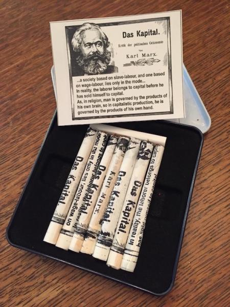 Smoking Marx, a tin of hand rolled cig.