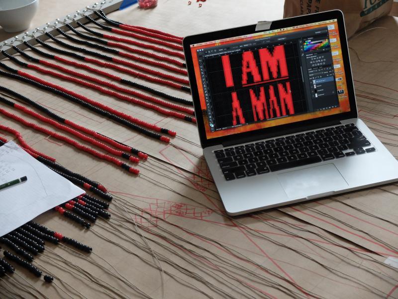 Artists Installing- I AM MAN