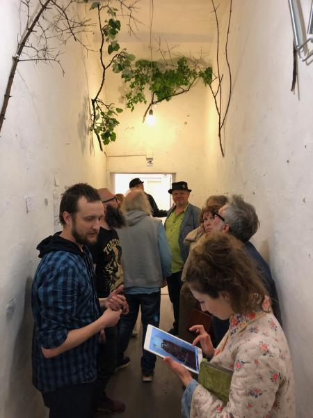 1.A St. Petersburgh arts collective takes of the hallways of a gallery to show work.  They are about to de-install.