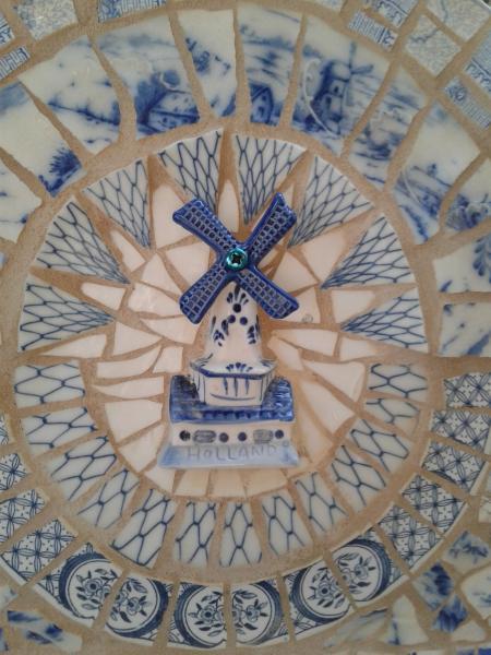 mosaic, pique assiette, mirror, china figure, windmill, Dutch